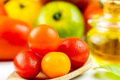 Varieties of colorful tomatos and olive oil Royalty Free Stock Photography