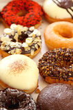 Varieties of decorated donuts Royalty Free Stock Photo