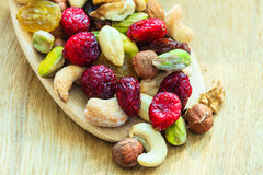 Varieties of dried fruits and nuts on wooden spoon. Stock Photography