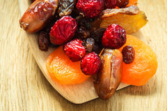 Varieties of dried fruits on wooden spoon. Stock Photography