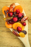 Varieties of dried fruits on wooden spoon. Royalty Free Stock Photo