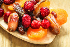 Varieties of dried fruits on wooden spoon. Stock Image