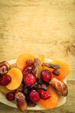Varieties of dried fruits on wooden spoon. Royalty Free Stock Photography