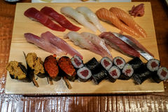 Varieties of fresh seafood sushi served on wooden platter with g stock photos