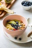 Varieties of fruits and nuts on Greek yogurt Stock Photos