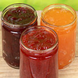 Varieties of Marmalade. Made from strawberries, cherries and apricots in jars Royalty Free Stock Image