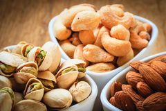 Varieties of nuts: cashew, pistachio, almond. Royalty Free Stock Images