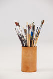 Varieties of paint brushes in jar Royalty Free Stock Photography