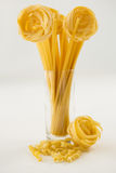 Varieties of pasta forming flower in glass container Royalty Free Stock Photography