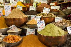 Varieties of Spice Powders in Traditional Copper Bowls in an Old Bazaar of Iran. Varieties of colorful aromatic spice powders and dried herbs in traditional Stock Images