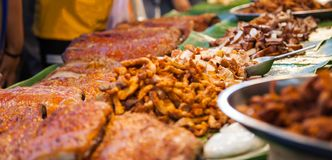 Varieties of traditional Thai Asian delicious street food, Crispy Delicious Barbecued Pork Belly in night food market. Food Travel. Asia Culture, Comfort Food stock photo