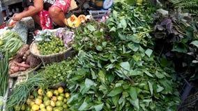 Varieties of wild edible vine vegetables are sold in street flea market to poor buyers.