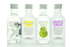 Variety of Absolut flavoured vodka isolated on white background Royalty Free Stock Photos