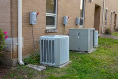 Variety of air conditioner units outside of commerical building royalty free stock photos