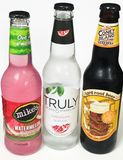 A Variety of Alcoholic Beverages. Including hard lemonade, and hard root beer Stock Photos