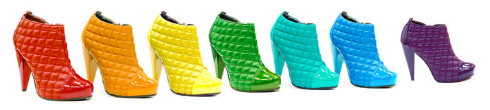 Variety of all rainbow colors in shoes or boots Stock Photo