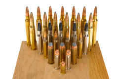 Variety of Ammunition. Ammunition of various types and sizes from 320 Auto to 300 Win Mag, arranged in the form of a triangle,  on white Stock Image