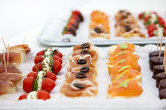 Variety of Appetizers Arranged on Platters Stock Photography