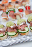Variety of Appetizers Arranged on Platters Stock Image