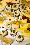 Variety of Appetizers on Cheese Platter Royalty Free Stock Image