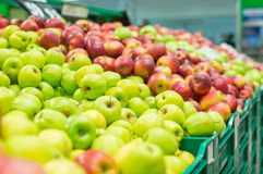Variety of apples in boxes in supermarket Stock Photo