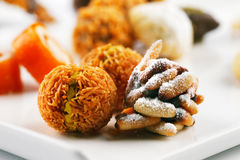 A variety of Arabic sweets on a white background Royalty Free Stock Photos