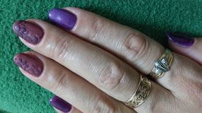 Multi-colored nails with a relief pattern. royalty free stock photos