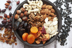 Nuts and dried fruits. Variety of 12 assorted nuts and dried fruits Stock Photo