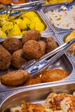 Cutlets, potatoes on the counter with metal kitchen tongs Stock Image