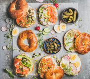 Variety of bagels with different fillings for breakfast or takeaway Stock Image