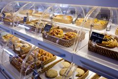 Variety of baked products in baskets with bread name and price o