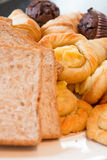 Variety of bakery products. On white table royalty free stock photos