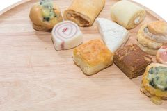 A variety of bakery. On wooden plate Royalty Free Stock Image
