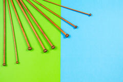 Variety of bamboo knitting needles in different sizes on colorful background Royalty Free Stock Photo