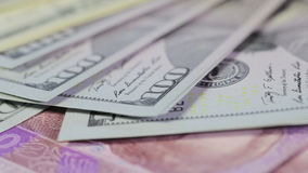 Variety of banknotes. Hryvnia, rubles, dollars and euros rotate stock video