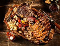 Variety of barbecue meat served on table royalty free stock photography