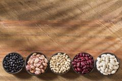 Variety of beans - black, pinto, mung, red, white and black eye stock image