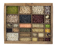 Variety of beans, grains and seeds in vintage box stock photography