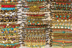 Variety of Beautiful Shiny Color Stone Bracelets for Sale in The Market Stock Images