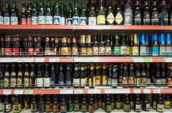 Variety of Belgian crafted beers on shop shelf display. Bruges, Belgium - 27 August, 2018: Variety of Belgian crafted beers for sale in a shop, branded bottles stock photos