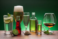 Variety of beverages on green background Stock Image