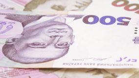 Variety of bills Ukrainian hryvnia. On the rotating surface there are bills of Ukrainian hryvnas of different dignity stock video