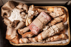 Variety of bread. Ciabatta, grissini, malted and beet bread Stock Image