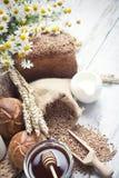 Variety of bread,fresh rolls, milk and honey Stock Photos