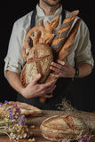 Variety of bread hold men`s hands Royalty Free Stock Images