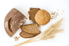 Variety of bread and stalks of wheat. On white Royalty Free Stock Photos