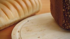 Variety of bread on the table in kitchen with stock footage