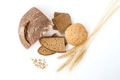 Variety of bread   on white. Variety of bread and stalks of wheat  on white Stock Photo