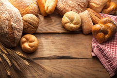 Variety of Bread on wooden table Royalty Free Stock Photography