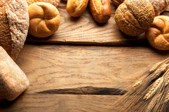 Variety of Bread on wooden table Royalty Free Stock Photo